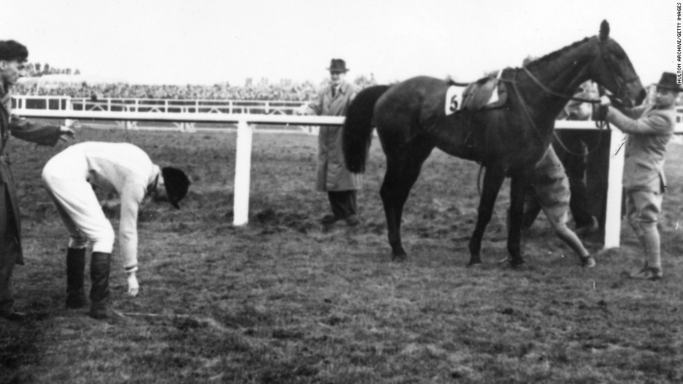 In 1956, the Queen Mother's horse Devon Loch famously fell while leading the prestigious Grand National steeplechase, unseating jockey Dick Francis just yards from victory.