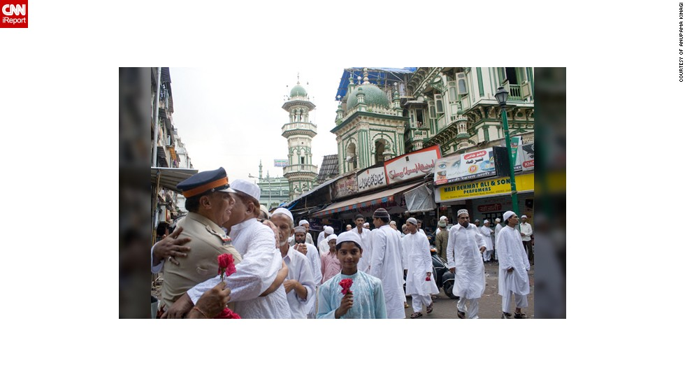 "This <a href=""http://ireport.cnn.com/docs/DOC-1012383"" target=""_blank"">moment of brotherly love</a> was taken by Anupama Kinagi in Mumbai, India: ""Muslims had just offered prayers and were wishing each other a very happy Eid. It is absolutely fine to hug and wish strangers on this auspicious occasion. The police officer specially arranges for rose flowers and greets Muslims outside Masjid on this special day. The Muslims accept their wishes and thank them for their extraordinary service,"" said the 37-year-old graphic designer."