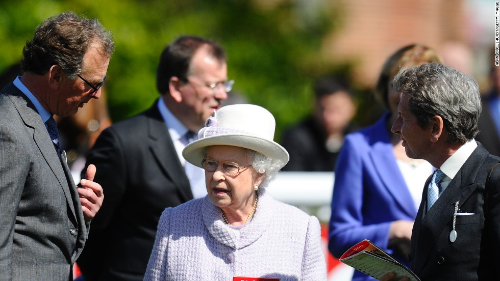 Queen Elizabeth II with her racing manager John Warren (left) and trainer Roger Charlton at Newbury racecourse in April 2013. Her horse Sign Manual was among the winners at the meeting.