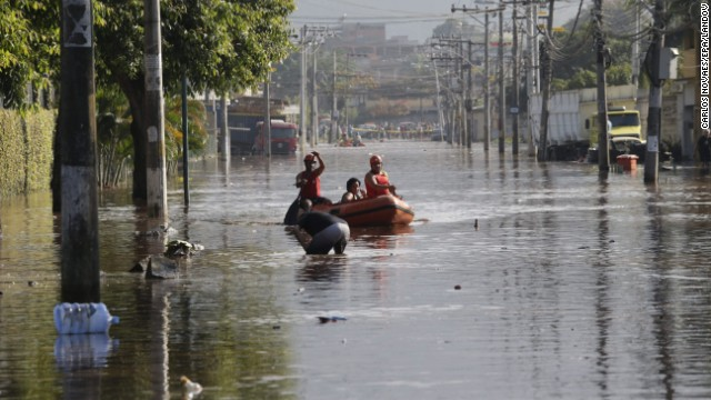 Rescue workers navigate the flooded neighborhood of Campo Grande on the outskirts of Rio de Janeiro, Brazil on Wednesday.