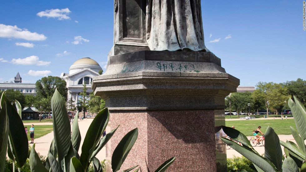 The paint on the statue of the Smithsonian's first secretary was discovered the same day as the Lincoln Memorial vandalism.