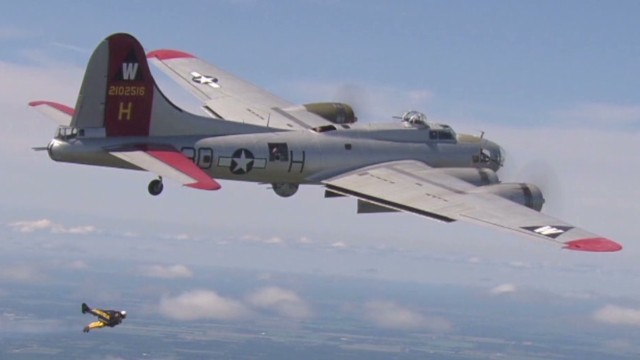 'Jetman' flies alongside B-17 bomber
