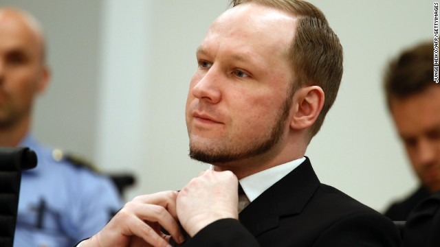 Self confessed mass murderer Anders Behring Breivik adjusts his tie in court room 250 at Oslo District Court on August 24, 2012. An Oslo court today found Anders Behring Breivik guilty of 'acts of terror' and sentenced him to 21 years in prison for his killing spree last year that left 77 people dead. AFP PHOTO / POOL / HEIKO JUNGE (Photo credit should read Junge, Heiko/AFP/GettyImages)