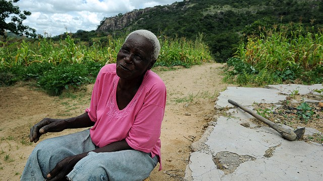 Matilda Mahlatini, 76, poses on March 15, 2013 in her village of Chinamhora, Zimbabwe. Mahlatini will not be joining hundreds of thousands of Zimbabweans voting in a referendum on March 16 on whether to adopt a new charter to pave way for new elections and a possible end to a shaky power-sharing government.