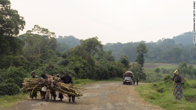 People walk on a road leading to the village of Kimbumba, in a M23 rebel-held territory, on July 25.