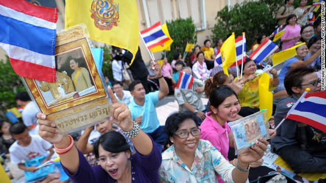 Well-wishers wait for Thailand's King Bhumibol Adulyadej outside Siriraj hospital in Bangkok on Thursday.