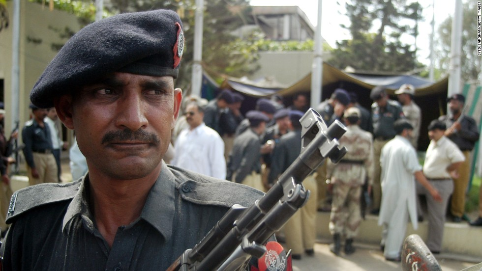 "A Pakistani police officer stands guard outside the <a href=""http://articles.cnn.com/2003-02-28/world/karachi.shooting_1_consulate-compound-bomb-attack-karachi"">U.S. Consulate in Karachi</a> after a gunman opened fire there on February 28, 2003. Two police officers were killed, and six others, including one civilian, were injured."