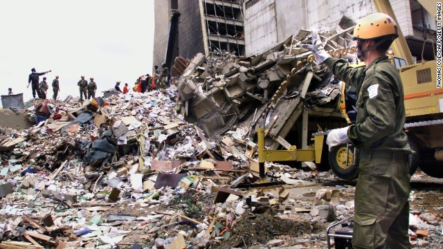 A rescue worker stands on the remains of what used to be the U.S. Embassy in Nairobi.
