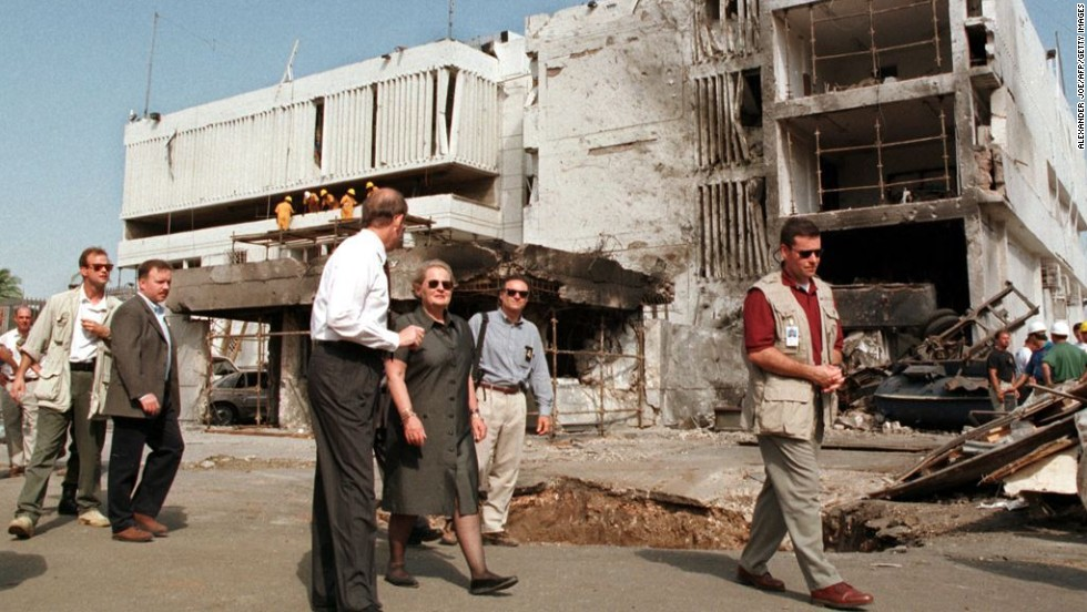 "Secretary of State Madeleine Albright, center, walks past the damaged <a href=""http://www.cnn.com/WORLD/africa/9808/08/africa.explosions.01/"">U.S. Embassy in Dar es Salaam</a> on August 18, 1998. The August 7 attacks in Tanzania and Kenya were later attributed to al Qaeda."