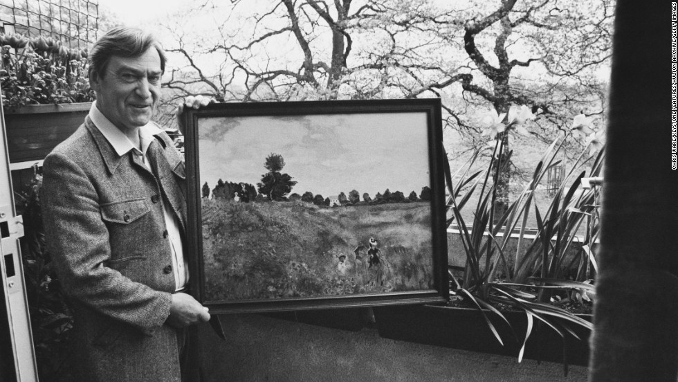 Patrick Troughton, who played the second Doctor from 1966-1969, holds one of his own paintings outside his home in Teddington, London, on May 5, 1981.