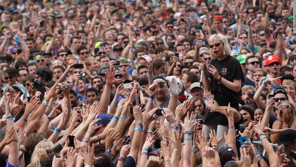 Alice Glass of Crystal Castles performs among the crowd on August 2.