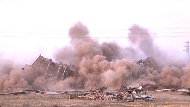 Debris from implosion injures three