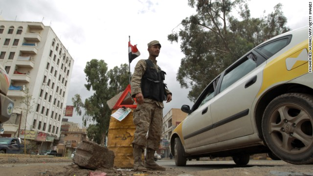 A Yemeni policeman stands at a check point in the capital Saana on August 3, 2013. The United States issued a worldwide warning that Al-Qaeda may attack in August as it ordered shut its embassies across the Islamic world. Britain also said it would temporarily close its embassy in Yemen as US lawmakers said the threat likely involved Al-Qaeda's franchise in the country. AFP PHOTO/ MOHAMMED HUWAIS (Photo credit should read MOHAMMED HUWAIS/AFP/Getty Images)