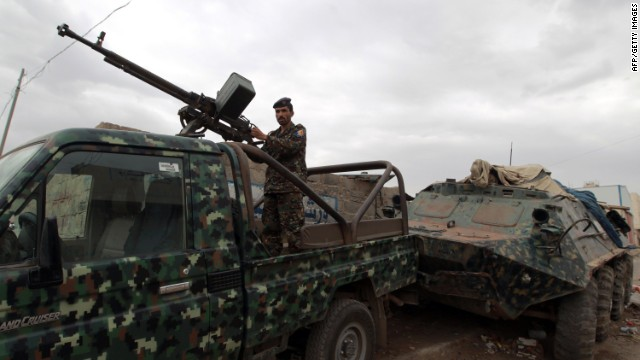 A Yemeni soldier mans a checkpoint on a street leading to the US embassy compound in Sanaa on August 4, 2013. Security measures were particularly strict in the Yemeni capital after Washington held urgent talks on an Al-Qaeda threat that prompted two dozen embassies and consulates to temporarily halt their services in many capitals in the region.