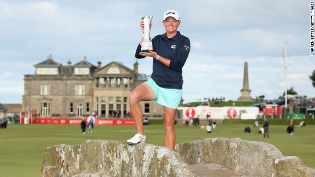 Stacy Lewis of the United States poses with the trophy on the Swilcan Bridge after winning the Women's British Open.