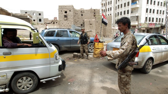 Yemeni police, man a check point, in the capital Saana on August 3, 2013. The United States issued a worldwide warning that Al-Qaeda may attack in August as it ordered shut its embassies across the Islamic world. Britain also said it would temporarily close its embassy in Yemen as US lawmakers said the threat likely involved Al-Qaeda's franchise in the country.