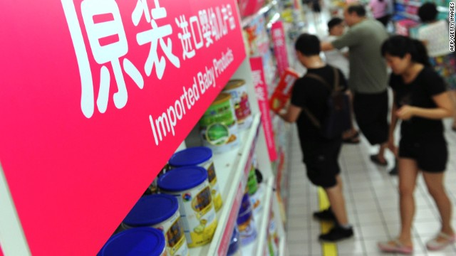 This picture taken on August 4, 2013 shows customers shopping in the imported baby products section while his parents purchase baby products of a supermarket in Beijing. New Zealand warned international health authorities on August 3 of exported dairy products, including infant formula, containing a bacteria that could lead to botulism -- a potentially fatal illness.