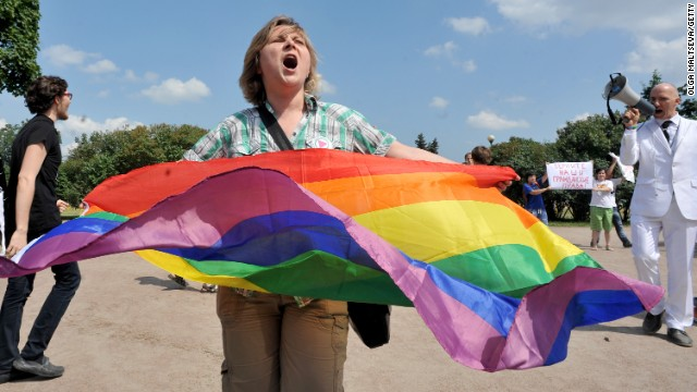 A gay rights activist holds a rainbow flag as she takes part in a gay pride event in Saint Petersburg on June 29, 2013. Russian police arrested dozens of people on June 29 after clashes erupted in the city of Saint Petersburg between pro- and anti-gay demonstrators. AFP PHOTO / OLGA MALTSEVA (Photo credit should read OLGA MALTSEVA/AFP/Getty Images)