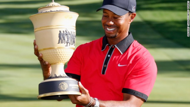 Tiger Woods holds aloft the Gary Player Cup after winning the WGC-Bridgestone Invitational in Ohio.
