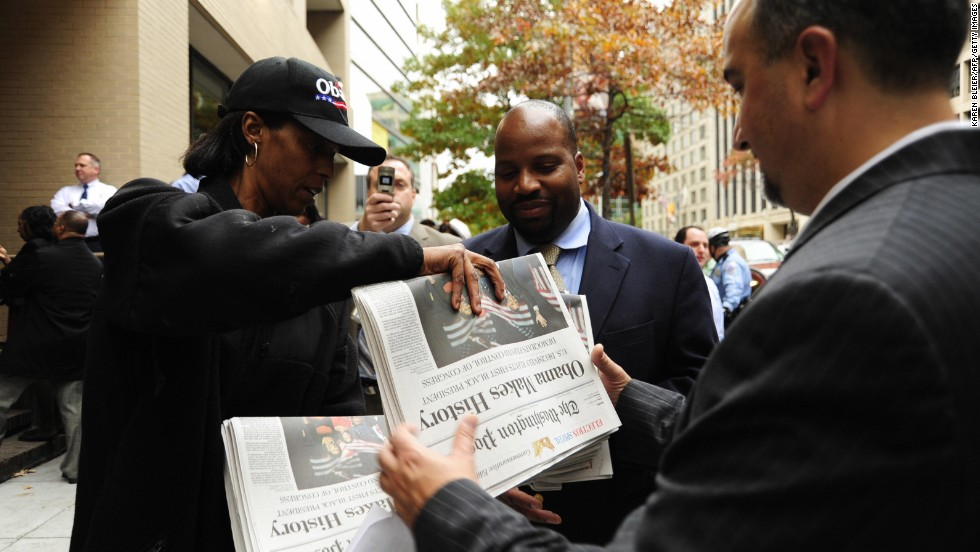 People take copies of the Post's special election edition on November 5, 2008, outside the newspaper's offices in Washington. The issue highlighted Barack Obama's historic presidential victory.