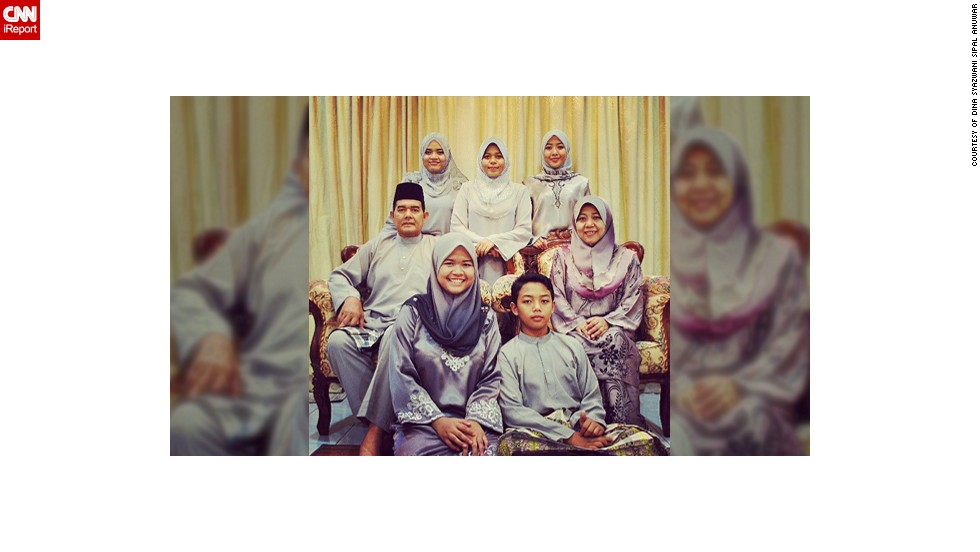 """Dina Syazwani Sipal Anuwar, a 24-year-old teacher from <a href=""""http://statigr.am/viewer.php#/user/175523476/"""" target=""""_blank"""">Selangor in Malaysia</a>, took this photo of her family celebrating Eid last year. The photo means a lot to her as it was the last Eid she was able to spend with her father Sipal, a policeman, who unexpectedly passed away in January 2013. It was also the first time the family had ever managed to color coordinate their outfits. """"I think it was one of the signs that father would be leaving us, last Eid we could take a perfect photo as a whole family,"""" said  Dina, pictured top left. This year the family have decided to all wear pink."""