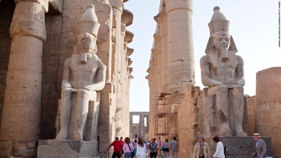 Don't limit yourself to one temple when visiting Egypt. A long promenade connects the temple at Luxor with the Karnak temple complex. Across the Nile are the royal tombs -- including the tomb of Tutankhamen -- in the Valley of the Kings. Tourists are shown here near statues inside Luxor Temple.