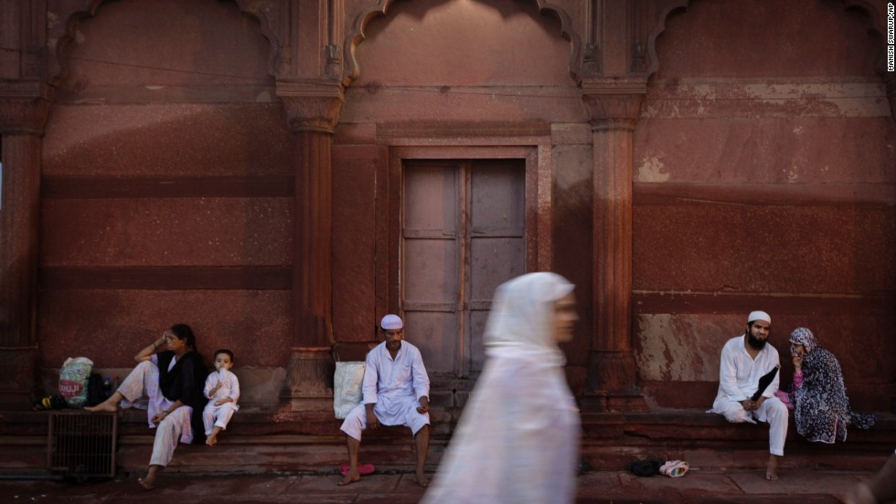 People wait for Iftar, the meal that breaks the daylong fast during Ramadan, on Tuesday, August 6, at the Jama Masjid, or Grand Mosque, in New Delhi, India.