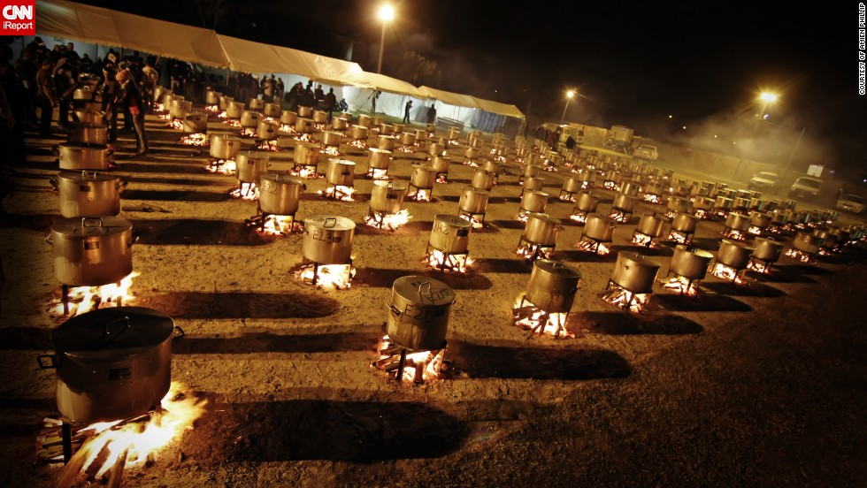 """The night cooking at the Nakhlistan Eid-al-fitr Feeding Scheme in <a href=""""http://ireport.cnn.com/docs/DOC-1013607 """" target=""""_blank"""">Cape Town, South Africa</a> was captured by Amien Phillips. More than 69,000 people were fed and five tons of meat, four tons of rice, 2.7 tons of potatoes, 850 kilograms of onions, 27,000 pieces of wood and 151 pots were used."""