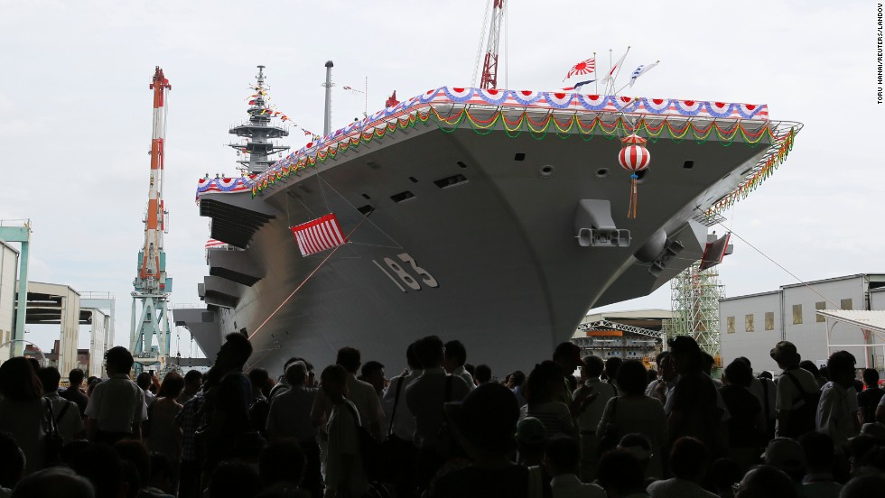 Crowds gather around the Izumo in Yokohama during the launching ceremony.