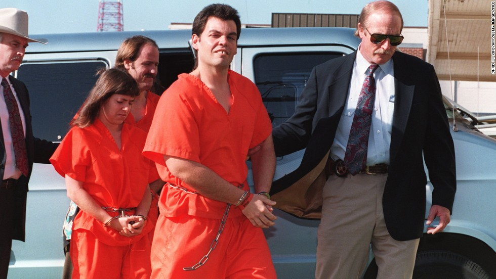 Left to right: Branch Davidian members Kathryn Schroeder, Brad Branch and Kevin Whitecliff are escorted on April 1, 1993, by U.S. Marshals into a federal court to be arraigned on charges stemming from the February 28 shootout at the compound.