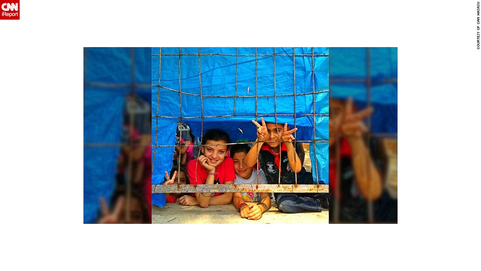 """This photo of <a href=""""http://statigr.am/viewer.php#/user/42266969/"""" target=""""_blank"""">Syrian refugee children</a> was taken last year at the Hatay's Yayladağı refugee camp in Turkey by TV journalist Can Hasasu. """"Eid, or Bayram as we call it in Turkey, is like Christmas for children, a cheerful feast. They collect money and gifts. Families buy new clothes for them. It was sad to see these children behind the fences of the camp. No money, no new clothes, no gifts and for some no family anymore. Despite all the sufferings in their country these children were smiling,"""" said the 36-year-old from Istanbul."""