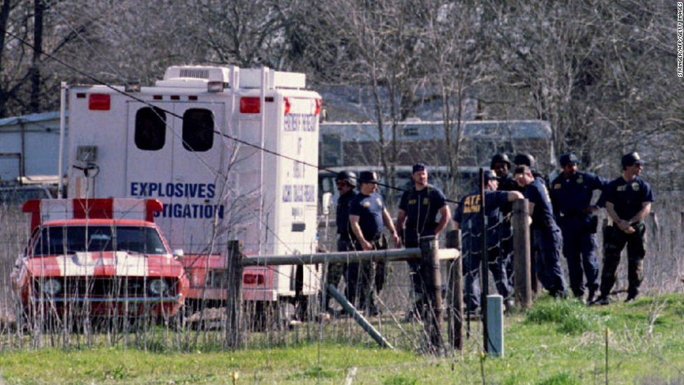 ATF agents gather near a bomb truck on March 8, 1993, as they search a building for arms near the compound.