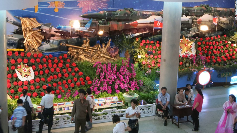 "North Koreans are big on military motifs and this year they've gone to town. Even a flower show features scores of missiles and tanks tucked in among the red ""Kimjongilia"" blossoms."