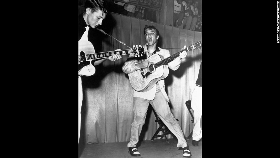 The rock 'n' roll singer performs on stage with his brand new Martin D-28 acoustic guitar at Fort Homer Hesterly Armory in Tampa, Florida, on July 31, 1955.