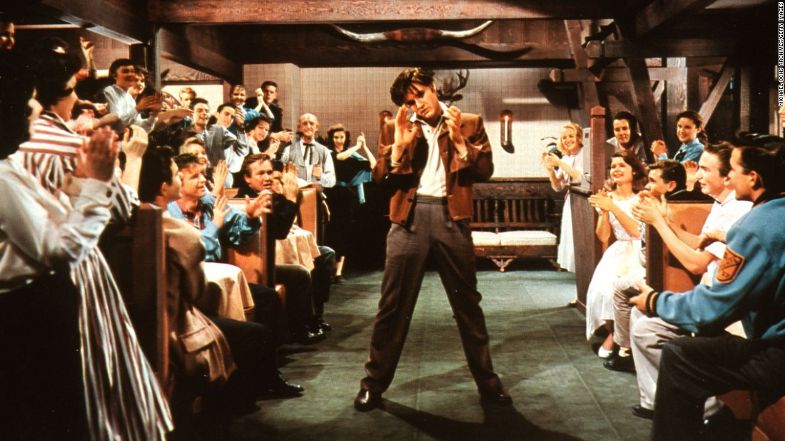 "Elvis performs in the 1957 movie ""Loving You."" He starred in 31 feature films and two performance documentaries in his lifetime."