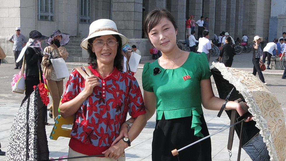 "All North Koreans wear a ""Kim pin"" on the left breast of whatever they are wearing. The pins show a portrait of Kim Il-Sung or his son, Kim Jong-Il, and sometimes both."