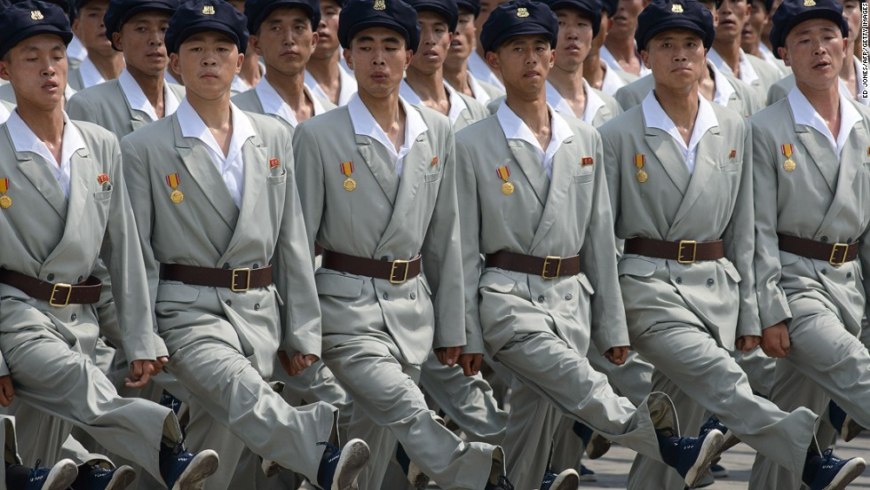 North Korean soldiers march through Kim Il-Sung square during a military parade. Forming perfect straight lines of people is not limited to the military. The training begins at a young age and by the time they are in their teens a crowd of hundreds can organize themselves into any number of parallel lines, equally spaced, in a minute.
