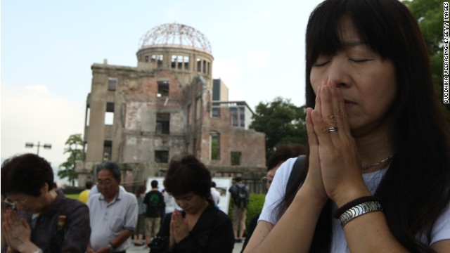 People pray in front of the Atomic Bomb Dome in Hiroshima on the 68th anniversary, August 6, of the day the atom bomb hit.