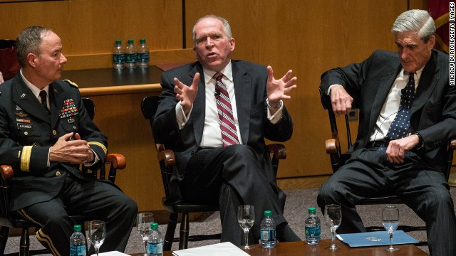 General Keith B. Alexander (L); John O. Brennan (C); and Robert S. Mueller II (R), take part in a Q&A forum during the International Conference on Cyber Security.