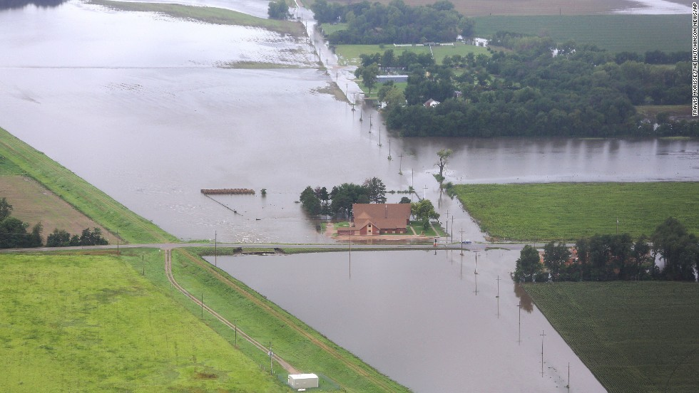 "Floodwaters surround Mitchell United Methodist Church at a levee in Hutchinson, <a href=""http://www.cnn.com/2013/08/08/us/u-s-weather/index.html"">Kansas</a>, on August 8."
