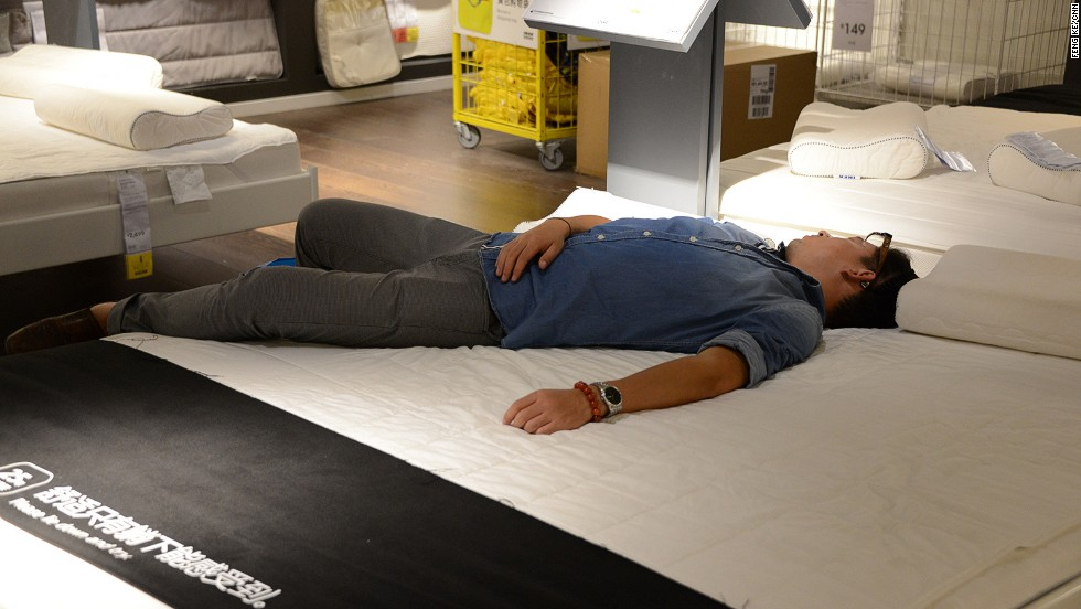"""Ikea's latest mattress commercial? """"You can only feel the comfort when you lie down,"""" says the sign in Chinese. This """"customer"""" needed no further invitation."""