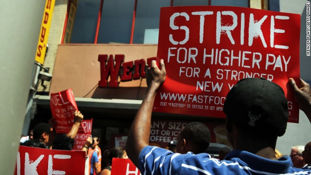 NEW YORK, NY - JULY 29: Employees and supporters demonstrate outside of a Wendy's fast-food restaurant to demand higher pay and the right to form a union on July 29, 2013 in New York City. Across the country thousands of low-wage workers are expected to walk off their jobs Monday at fast food establishments in seven U.S. cities. Workers at KFC, Wendy's, Burger King, McDonald's and other restaurants are calling for a living wage of $15 an hour and the right to form a union without retaliation. (Photo by Spencer Platt/Getty Images)