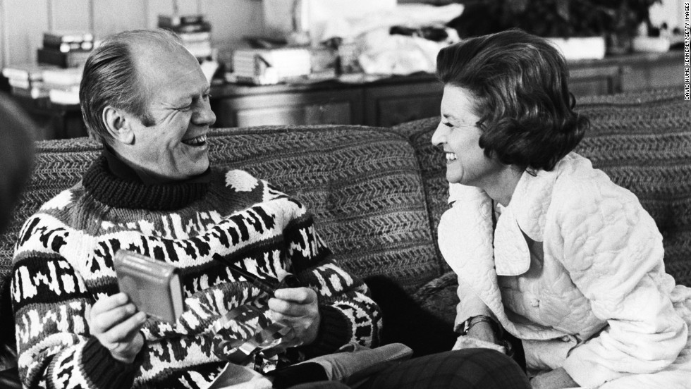 President Gerald Ford opens a gift from his wife, Betty, during their usual Christmas holiday vacation spot in Vail, Colorado, in December 1974.