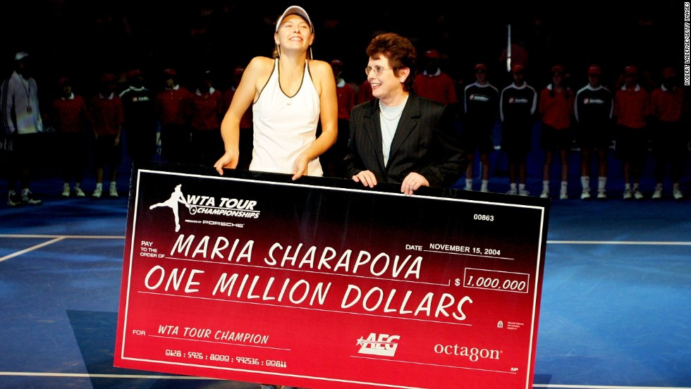 King presents Maria Sharapova with a check for $1 million after the Russian superstar won the WTA Championships in 2004 --  beating Serena Wiliams in the final.