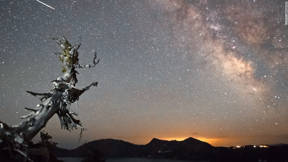 """Shooting for six to seven hours from sundown to sunrise, <a href=""""http://ireport.cnn.com/docs/DOC-828533"""">Abe Blair </a>captured this image around just past midnight on August 13, 2012, in Crater Lake, Oregon. """"This was my first time watching a meteor shower and this was the image I was hoping to capture,"""" he said."""