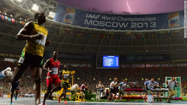 Lighting strikes as Jamaica's Usain Bolt wins the 100 meter final at the Moscow World Championships in Moscow on Sunday.
