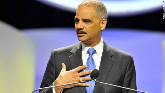 "Attorney General Eric Holder, shown speaking in August, said the new sentencing guidelines would ""better enhance public safety."""