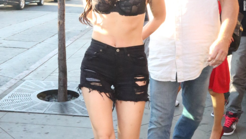 Lady Gaga struts in a bra and black shorts in West Hollywood on August 11.