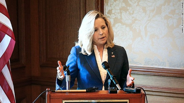 Liz Cheney answers a question from a reporter after announcing her bid for Senate in Wyoming.