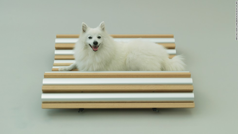 "Hiroshi Naito's ""Dog Cooler"" is perfect for the fluffy, furry spitz. A flexible design allows for multiple configurations, with metal tubes as hiding places for doggie treats."